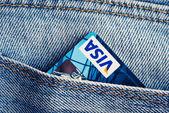 Visa Debit Cards in blue denim jeans pocket. — Stock Photo