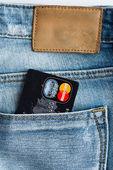 Mastercard Debit Cards in blue denim jeans pocket. — Stock Photo