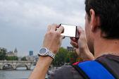 Tourist taking photo with  smart phone  — Stock Photo