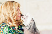 Woman and chinese crested dog — Stock Photo