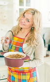 Young woman with sauce pan — Stock Photo