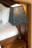 Lamp on a night table — Stock Photo