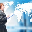 Businesswoman standing in front of an earth map — Stock Photo