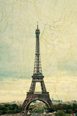 Famous Eiffel Tower in Paris, France. Grunge style photo.  — Stock Photo