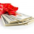 Money gift with red bow — Stock Photo #50799235