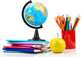 Globe, notebook stack and pencils. — Stock Photo