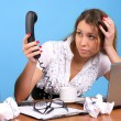Beautiful businesswoman looking to telephone handset — Stock Photo #5301458