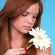 Beautiful young woman with flower — Stock Photo #5447938