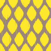 Ikat yellow rhomb seamless pattern — Stock Vector