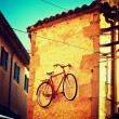 Old photo of bike on wall — Stock Photo