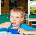 Boy eating ice cream — Stock Photo #44732987