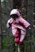 Halloween scary scarecrow in autumn forest — Stock Photo
