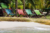 Colorful deckchairs on the beach of tropical island, Thailand — Stock Photo
