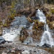 Small waterfall in spring forest — Stock Photo #46704117