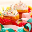 Cupcakes with whipped cream — Stock Photo #12241453