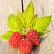 Raspberry on wooden table — Stock Photo #12809449
