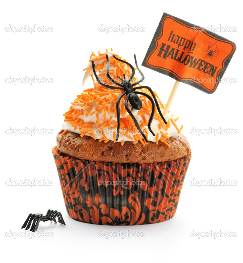 Halloween cupcake with whipped cream and decoration isolated on white  Foto de Stock   #12834089