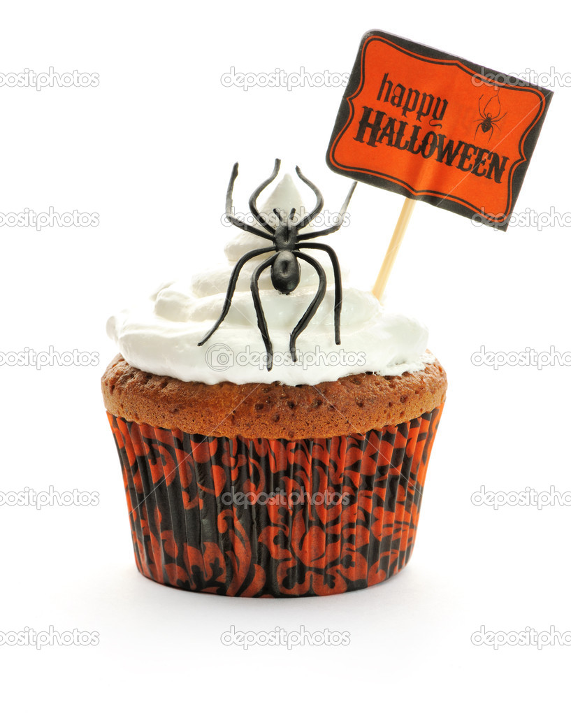 Halloween cupcake with whipped cream and decoration isolated on white — Stock Photo #12834091