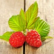 Raspberry on wooden table — Stock Photo #13125472