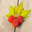 Raspberry on wooden table — Stock Photo #13490217