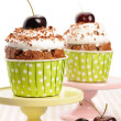 Cupcakes with whipped cream and cherry — Stock Photo #13664340