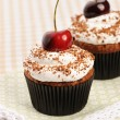 Cupcakes with whipped cream and cherry — Stock Photo #13664346