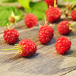 Raspberry on wooden table — Stock Photo #13664380