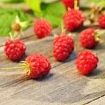 Raspberry on wooden table — Stock Photo