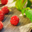 Raspberry on wooden table — Stock Photo