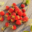 Raspberry on wooden table — Stock Photo #13798085