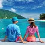 Couple at beach jetty — Stock Photo #13798184