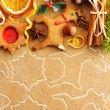 Stock Photo: Christmas spices and cookies over gingerbread dough