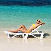 Girl on a beach — Stock Photo