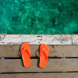 Sandals at jetty — Stock Photo
