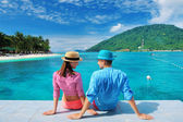 Couple at beach jetty — Stock Photo