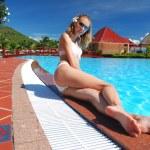 Girl near pool — Stock Photo #1656530
