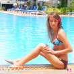 Girl near tropical pool — Stock Photo #1693579
