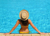 Woman at poolside — Stock Photo