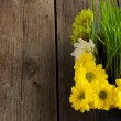 Grass and flowers over wood - Stock Photo