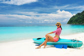 Woman in sunglasses at beach — Stock Photo