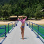 Woman at beach jetty — Stock Photo #20380609