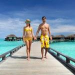 Couple on a beach jetty at Maldives — Stock Photo #21610987