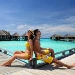 Couple on a beach jetty at Maldives — Stock Photo #21611007