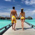 Couple on a beach jetty at Maldives — Stock Photo