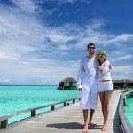 Couple on a beach jetty at Maldives — Stock Photo #21611039