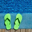 Sandals by a swimming pool  — Stock Photo