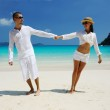 Couple in white on a beach — Stock Photo #21613211