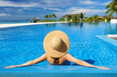 Woman at poolside — Stockfoto