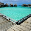 Beautiful beach with water bungalows — Stock Photo #22170621