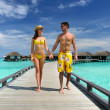Couple on a beach jetty at Maldives — Stock Photo #22170623